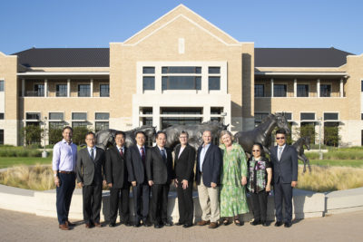 Group photo of NCHU delegation and CVM faculty in front of College of Veterinary Medicine